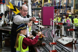 Volunteer Peter M Webster, helping Carr students signal trains